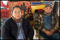 Couple sitting in front of carpets. Guanajuato, Mexico ( color)