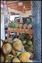 Tropical Fruit stand with girl in background. Mexico ( color)