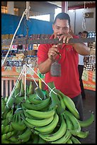 Man weighting bananas. Mexico ( color)