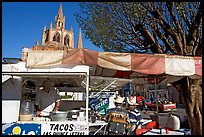 Taco stand on town plaza with cathedral in background. Mexico ( color)