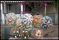 Floral wheels in a cemetery. Mexico ( color)