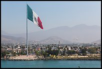 Giean Mexican national flag flying above Malecon, Ensenada. Baja California, Mexico (color)