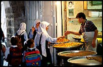 Muslem women purchasing sweets. Jerusalem, Israel (color)