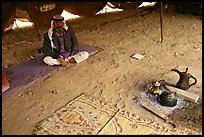 Bedouin man sitting on a carpet in a tent, Judean Desert. West Bank, Occupied Territories (Israel)