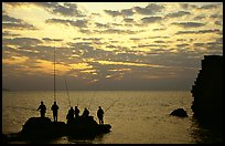 Fishermen standing on a rock, Akko (Acre). Israel (color)
