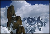 Alpinists on a pinacle of Aiguille du Midi after climbing the South Face