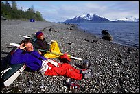 Kayakers relaxing on a beach between Rendu Inlet and Russel Island. Glacier Bay National Park, Alaska (color)