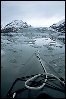 Kayaks prow, floating icebergs, and glacier. Glacier Bay National Park, Alaska (color)