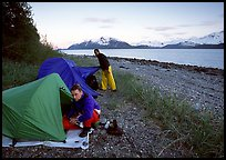 Kayakers getting into their tents for the night,  East Arm. Glacier Bay National Park, Alaska