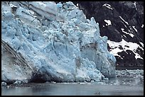 Kayaker paddling bellow Lamplugh Glacier. Glacier Bay National Park, Alaska (color)