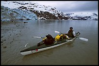 Kayaker sitting in loaded double kayak near Lamplugh Glacier. Glacier Bay National Park, Alaska