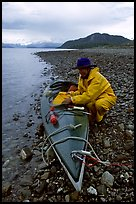 Kayaker unloading kayak. Glacier Bay National Park, Alaska (color)