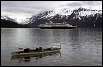 Kayak and cruise ship, East arm. Glacier Bay National Park, Alaska (color)