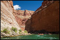 Rafts dwarfed by huge Redwall limestone canyon walls. Grand Canyon National Park, Arizona