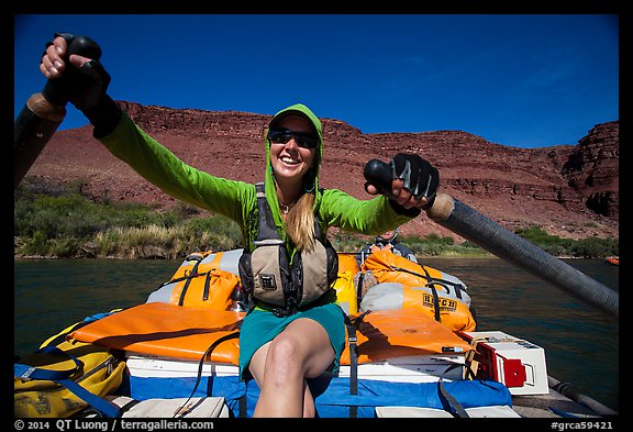 Woman paddling oar-powered raft. Grand Canyon National Park, Arizona