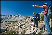 Hikers looking at map and pointing, Dusy Basin. Kings Canyon National Park, California