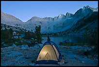 Tent with light and Palisades at dusk, lower Dusy Basin. Kings Canyon National Park, California