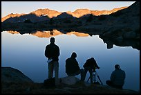 Film crew in action at lake, sunrise, Dusy Basin. Kings Canyon National Park, California (color)