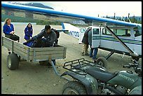 Unloading the gear from the plane to a trailer on the Port Alsworth airstrip. Lake Clark National Park, Alaska