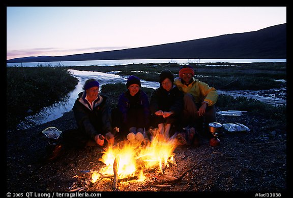 Warming toes on campfire next to Turquoise Lake. Lake Clark National Park, Alaska