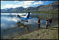 Backpackers being picked up by floatplane at Twin Lakes. Lake Clark National Park, Alaska