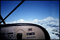 From the cockpit. The three main summits of the range are, from left to right, Mt Foraker, Mt Hunter, and Mt McKinley, which is cloud-capped, as often. Alaska