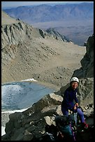 Woman gearing up to climb  East face of Mt Whitney. Sequoia National Park, California (color)