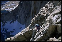Mountaineer among broken rocks in the East face of Mt Whitney. Sequoia National Park, California (color)