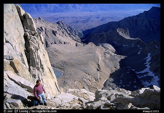 Man pausing on steep terrain in the East face of Mt Whitney. Sequoia National Park, California