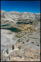 Hikers on trail above Saddlebag Lakes, John Muir Wilderness. Kings Canyon National Park, California (color)