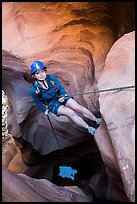 Woman at the start of free hanging rappel in Pine Creek Canyon. Zion National Park, Utah ( color)