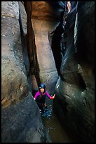 Canyoneer in tight and wet section of Das Boot Canyon. Zion National Park, Utah ( color)