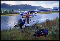 Backpackers beeing dropped off by a floatplane at Circle Lake. Gates of the Arctic National Park, Alaska
