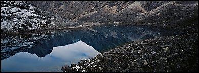 Mountain lake with reflections in rocky environment. Gates of the Arctic National Park (Panoramic color)