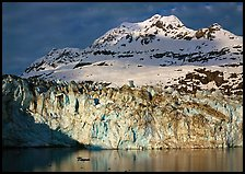 Face of Lamplugh Glacier illuminated by the sun on cloudy day. Glacier Bay National Park, Alaska, USA. (color)