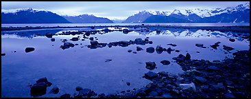 Blue scenery of water and mountains at dusk. Glacier Bay National Park (Panoramic color)