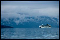 Cruise vessel in blue seascape. Glacier Bay National Park ( color)