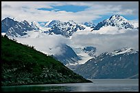 Peaks of Fairweather range with clearing clouds. Glacier Bay National Park, Alaska, USA. (color)