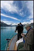 Movie producer taking notes as crew films. Glacier Bay National Park, Alaska, USA. (color)