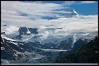Pointed peaks of Fairweather range emerging from clouds. Glacier Bay National Park ( color)