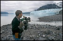 Cameraman filming in Tarr Inlet. Glacier Bay National Park, Alaska, USA. (color)