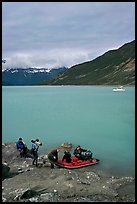 Film crew embarking on a skiff after shore excursion. Glacier Bay National Park, Alaska, USA. (color)