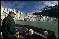 Captain guiding boat near Lamplugh glacier. Glacier Bay National Park ( color)