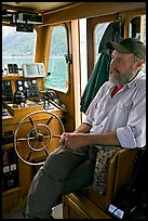 Captain sitting at the wheel. Glacier Bay National Park ( color)