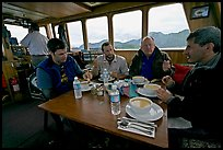 Passengers eating a soup for lunch. Glacier Bay National Park, Alaska, USA. (color)
