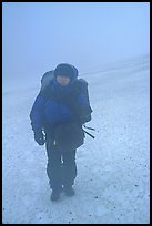 Backpacker in white-out conditions, Valley of Ten Thousand smokes. Katmai National Park, Alaska