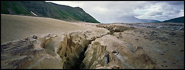 Volcanic landscape with deep gorge cut into ash valley. Katmai National Park (Panoramic color)