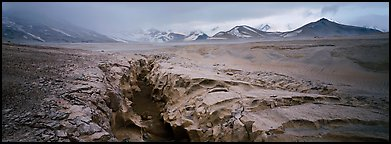 Stormy landscape with ash-covered valley and mountains. Katmai National Park (Panoramic color)