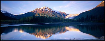 Mountains and glacier reflected in Resurrection River. Kenai Fjords National Park, Alaska, USA.