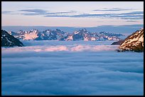 Resurrection Mountains emerging from clouds at sunset. Kenai Fjords National Park ( color)
